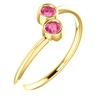 This cute 14k yellow gold pink tourmaline ring features two bezel set tourmalines with a warm pink hue.