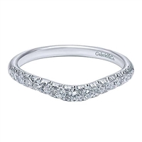 This 14k white gold diamond wedding band is curved.