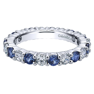 Round diamonds and sapphires alternate in this shimmering 14k white gold eternity band!