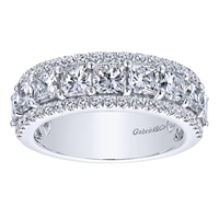 This beautiful and dynamic round and asscher cut diamond band gleams with over 2.50 carats of diamonds set into this 14k white gold diamond wedding band.