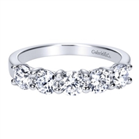 Diamonds and 14k white gold form a perfect partnership, mirroring you and your partner's! Featured with 5 round diamonds with a total diamond weight of 1.25 carats in this traditional diamond wedding band.
