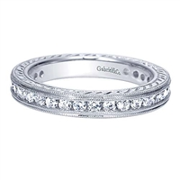This unique diamond eternity band is studded with 0.90 carats of round brilliant diamonds in an eternity style.