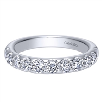 One carat of round diamonds shine in a 14k white gold diamond wedding band!