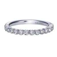 This simple and stylish diamond wedding band is featured in 14k white gold, to go along with 0.17 carats of round brilliant diamonds.