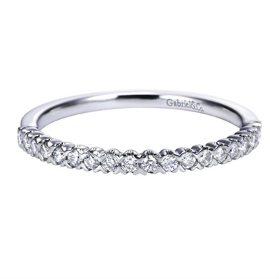 This white gold diamond wedding band astounds with round brilliant diamonds and a bold and refined look.