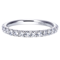 One half carats of round brilliant diamonds make their way around a 14k white gold diamond wedding band in this uplifted classic!