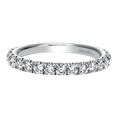 Glittering round diamonds sit pretty in 14k white gold in this diamond laden wedding band by Gabriel & Co.