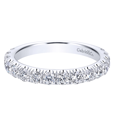 Diamonds wrap themselves three quarters around a 14k white gold band in this classic diamond wedding band.