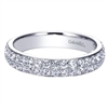 This diamond band blossoms with over 3/4 carats of high quality round diamond shimmer! Good for the wedding day or to celebrate an anniversary!