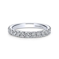 A 14k white gold diamond wedding ring laden with 0.95 carats of diamond shine.