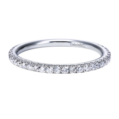 Round brilliant diamonds wrap 3/4 of the way around a shimmering 14k white gold ring in this white gold diamond wedding band with one third carats of round brilliant diamond shine.