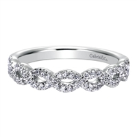 This 14k white gold diamond wedding band features white gold bands that loop around one another for a beautiful effect!