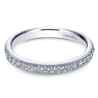 This milgrained 14k white gold diamond band features 0.26 carats of round brilliant diamonds.
