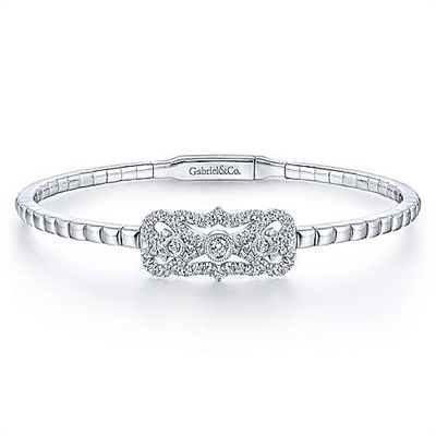 This white gold diamond bangle with a vintage style features nearly one half carats of round brilliant diamond shimmer.