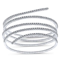 A swirling 14k white gold diamond bangle with over 2 carats of diamond splendor.