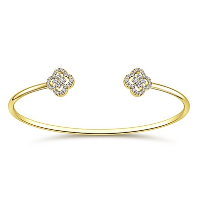 Two center diamond sections create this 14k yellow gold diamond cuff bracelet.