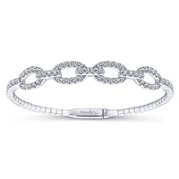 1.38 carats of brilliant diamond shine are set into this 14k white gold cuff bangle.