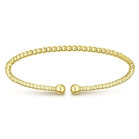 This 14k yellow gold cuff bangle bracelet is beautiful.
