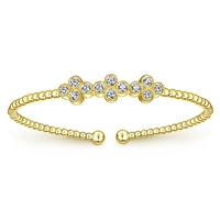12 round brilliant diamonds shine with 0.61 carats all in this 14k yellow gold cuff bracelet.