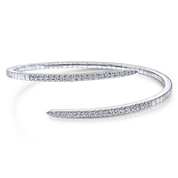 A diamond bangle featuring 0.94 carats of diamond shimmer in 14k white gold.