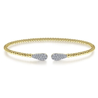 14k yellow gold cable cuff bracelet features two diamond sections.