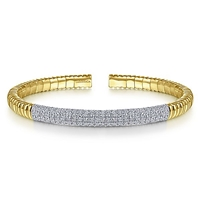 This 14k yellow gold cuff bangle features 2 carats of diamonds.