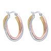 14k white gold mixes with rose and yellow gold is met with diamonds in these hoop earrings.