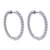 This 14k white gold diamond hoop pair of earrings features nearly 5 carats of round brilliant diamonds in this large and eye catching pair of eaarings.