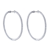 This modern twist on a traditional favorite features 1.62 carats of round brilliant diamonds shimmering all the way around these 14k white gold diamond hoop earrings.
