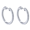 14k white gold mixes with round brilliant diamonds to create this contemporary take on the classic diamond hoop earring!