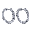 This 14k white gold diamond hoop pair of earrings features 1.98 carats of round brilliant diamonds shining all around this 14k white gold hoop setting.