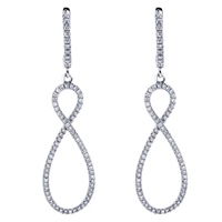 This figure 8 style 14k white gold pair of diamond earrings hangs gracefully and is a beautiful accessory for any woman.