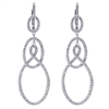 Three sets of round diamond drops hang from your ears in this pair of 18k white gold diamond drop earrings.