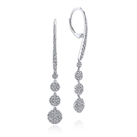 This 14k white gold pair of diamond earrings features three diamond drop discs feature over three quarter carats of diamond shine.