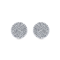 Set in a cluster style setting, 0.11 carats of diamonds in 14k white gold stud earrings.