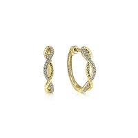 This pair of 14k yellow gold diamond hoop earrings features 0.11 carats of diamond shine.