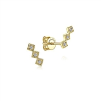 These 14k yellow gold diamond stud earrings feature 0.04 carats of diamonds.