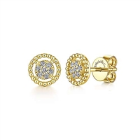 This pair of `4k yellow gold diamond stud earrings feature diamond accents floating in a beaded halo.