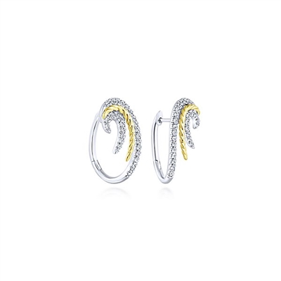 Swirling 14k white gold diamond huggie earrings with 0.55 carats of diamonds.