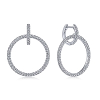 This 14k white gold double hoop diamond earrings feature 0.89 carats of diamonds.
