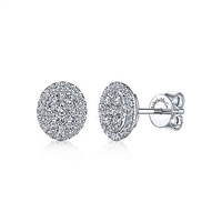 These diamond cluster stud earrings sparkle with 0.29 carats of round diamond shine.