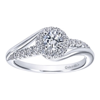 This freely styled round diamond engagement ring set up for a round center diamond shimmers with with one quarter carats of round brilliant diamonds is available in white gold or platinum.