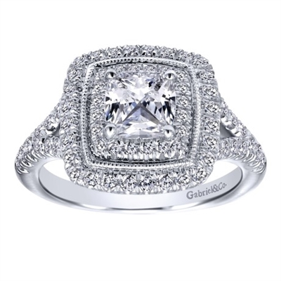 This ornate and pavé set diamond engagement ring snugly wraps around a cushion cut center diamond in this beautiful, unique and complex white gold cushion cut diamond engagement ring.