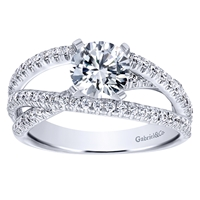 This round brilliant diamond engagement ring with a fresh new design shows off a round center diamond in the middle of over one half carats of round brilliant diamonds.