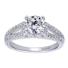 This wonderfully set round diamond split shank diamond engagement ring shimmers and glistens with over one quarter carats of round brilliant diamonds and is offered to you in white gold or platinum.