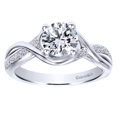 This fresh and modern take on a diamond engagement ring features a split shank to house a round center diamond, in white gold or platinum.