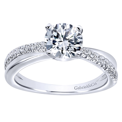 This cool round diamond engagement ring maintains a fresh and contemporary look with a single round diamond row that crosses over sleek white gold or platinum .