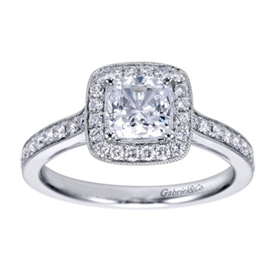This cushion cut halo diamond engagement ring is dripping with over one third carats of round brilliant diamonds, available in white gold or platinum!