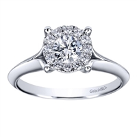 This subtle and sublime solitaire engagement ring features a split shank and holds a round center diamond,available in white gold or platinum.