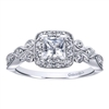 This flowing white gold or platinum princess halo engagement ring shimmers with almost one half carats of round brilliant diamonds, ad its rose-like shank is reminiscent of a flower in bloom.